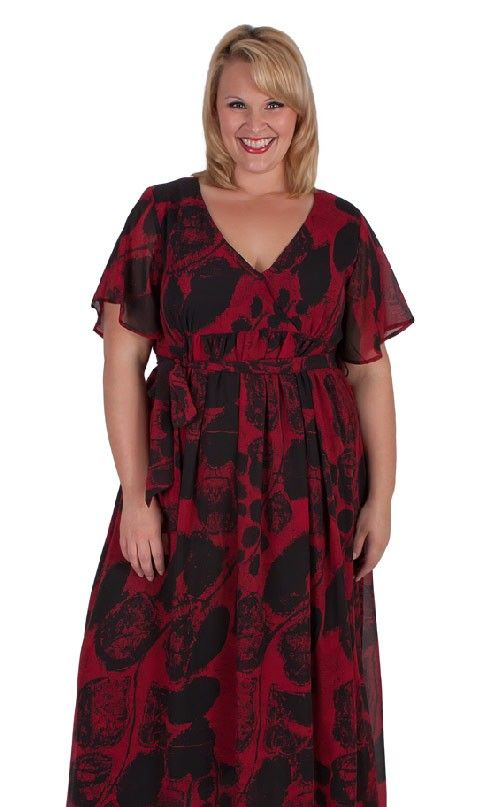 I am a clearance no return item. A beautiful plus size dress suited for weddings, evening wear or taking on a cruise.• Flowing chiffon outer layer material• Short wide cut sleeves for arm coverage and comfort• Long length and fully lined in a stretch light weight polyester• Material tie (detachable) • V neckline• We provide measurements of every garment. Click view size guide.
