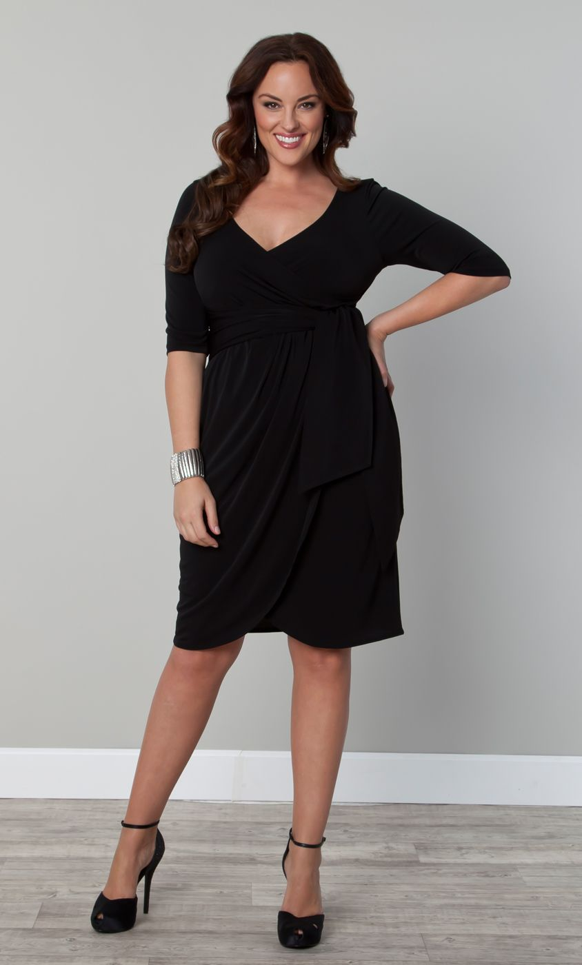 7046d24c00e1 The Plus Size Harlow Faux Wrap Dress by Kiyonna features flattering  sophisticated silhouette that can seamlessly take you from a day at the  office to ...