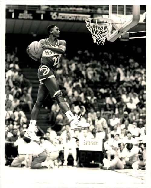 Dominique Wilkins going in for the windmill dunk! Love the