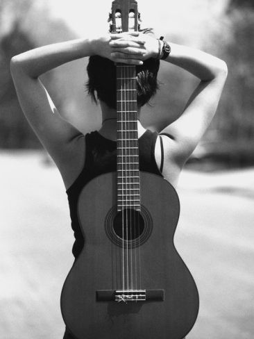 Young Woman Holding An Acoustic Guitar Behind Her Back By Anne W