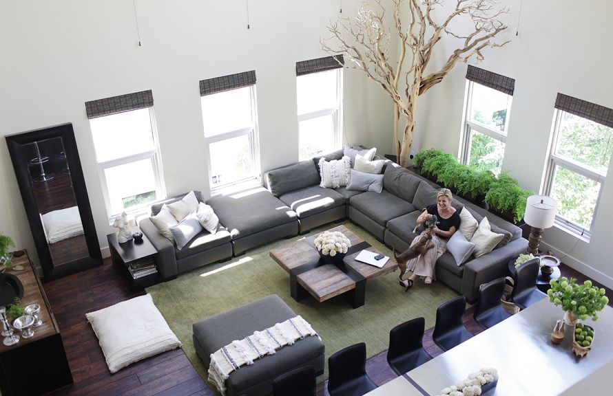 Love the earthy, clean modern look to this great room. Fabulous tree in the corner!