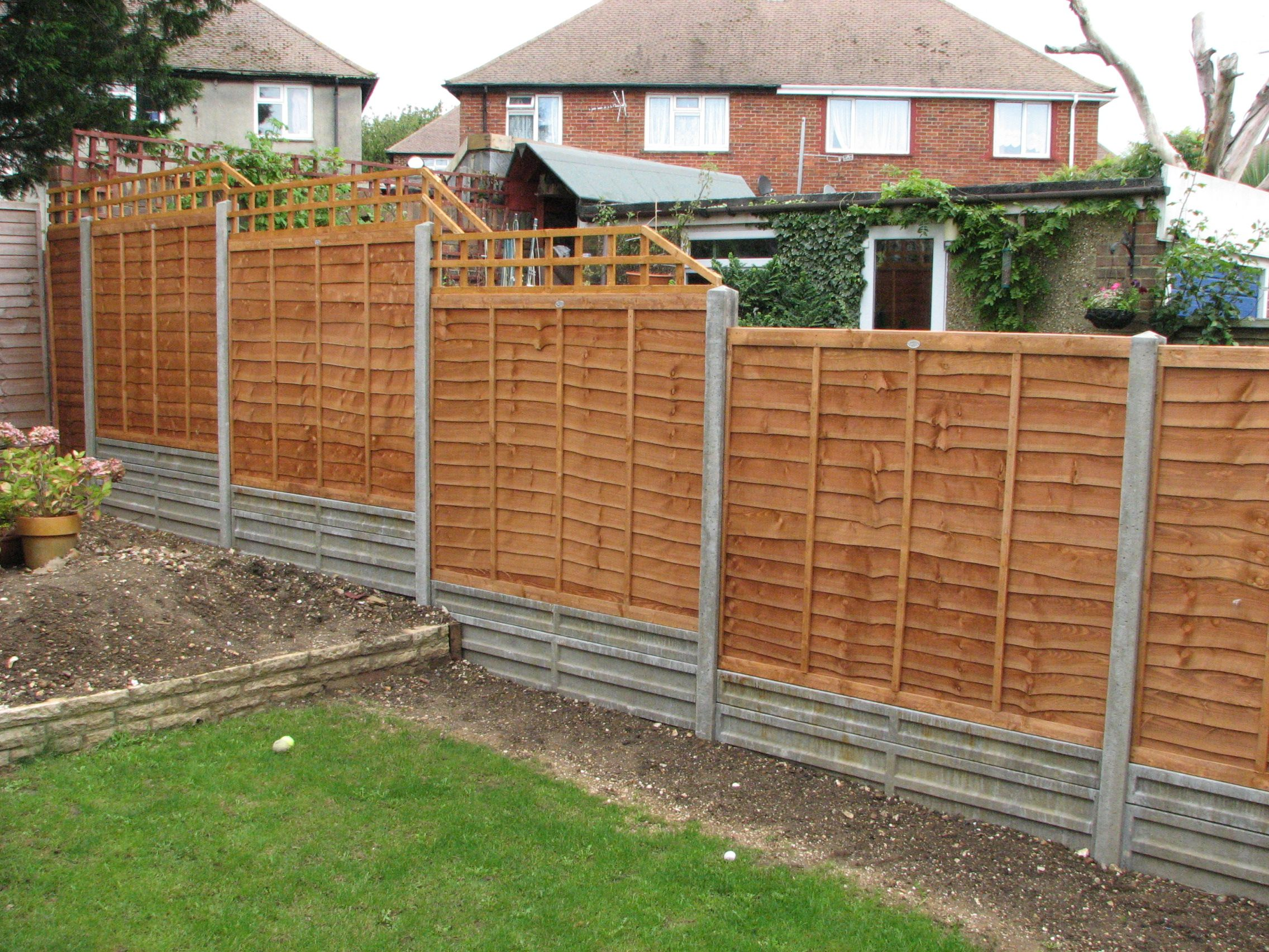 Fence lap panels used as garden fencing cheaper if for Garden barrier ideas
