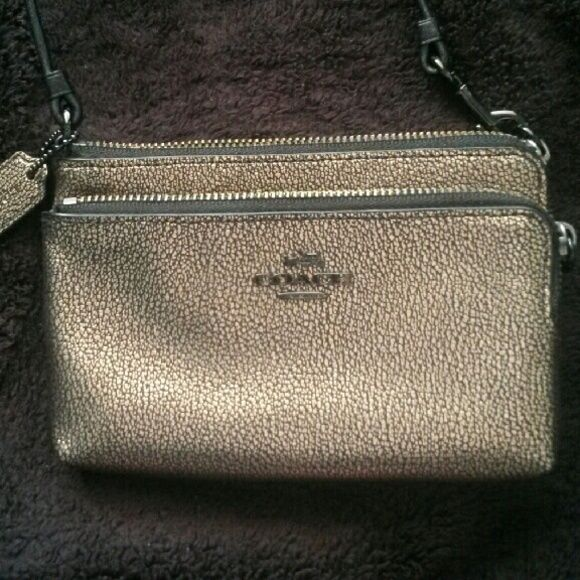 NWOT! Pebbled leather Coach wristlet Metallic gold Coach wristlet with black interior. Brand new! Double zippered pouch for extra storage! Coach Bags Clutches & Wristlets