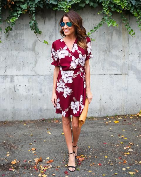 There is love in the air with our Air Of Romance Short Sleeve Wrap Dress! A gorgeous hued dress with white florals throughout is complimented in a true wrap dre