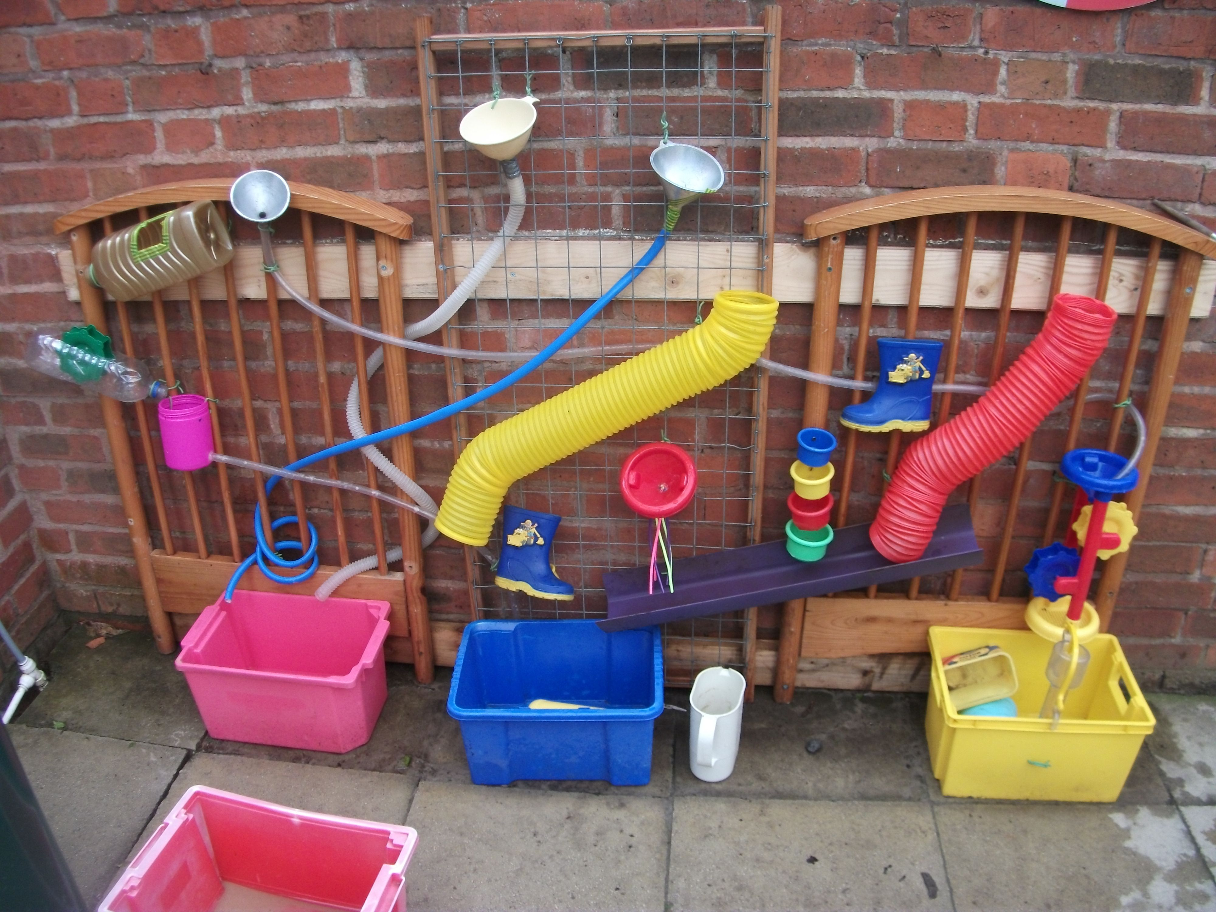 My Own Adaptation Of A Water Wall Recycling An Old Cot And Using Old Wellies Too Water Walls Natural Playground Outdoor Play Areas