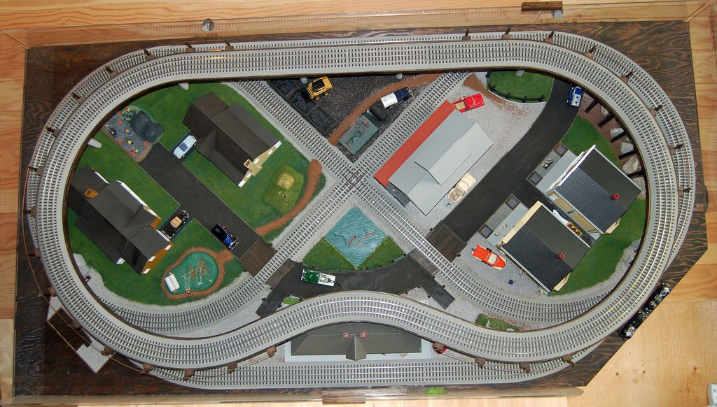 """O-Gauge Portable Train Layout  Portable compact 2 level layout in storage on the wall. Size 4' by 7'8"""" The 0-Gauge track used on this layout is Lionel FasTrack. Framework is 3/4"""" by 3"""" plywood with a 3/8"""" plywood top surface."""