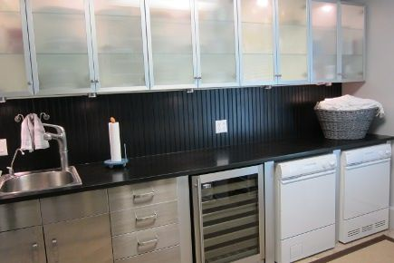 Stainless Front Cabinets Granite Counter And Black Bead Board In