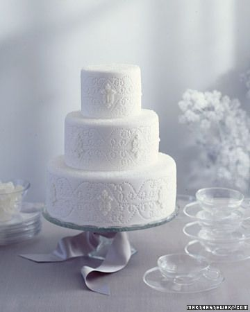 A simple white cake gets a lift from elegant designs pressed into the fondant.