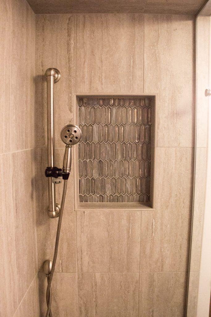 Shower Tile: 12x24 Travatini Al Contro Grigio; Niches: Mosaic Artemis Silver Haze; Grout: Silver