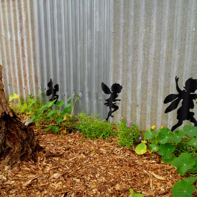 Mum's Painted Fairy Silhouettes On Corrugated Iron Fence