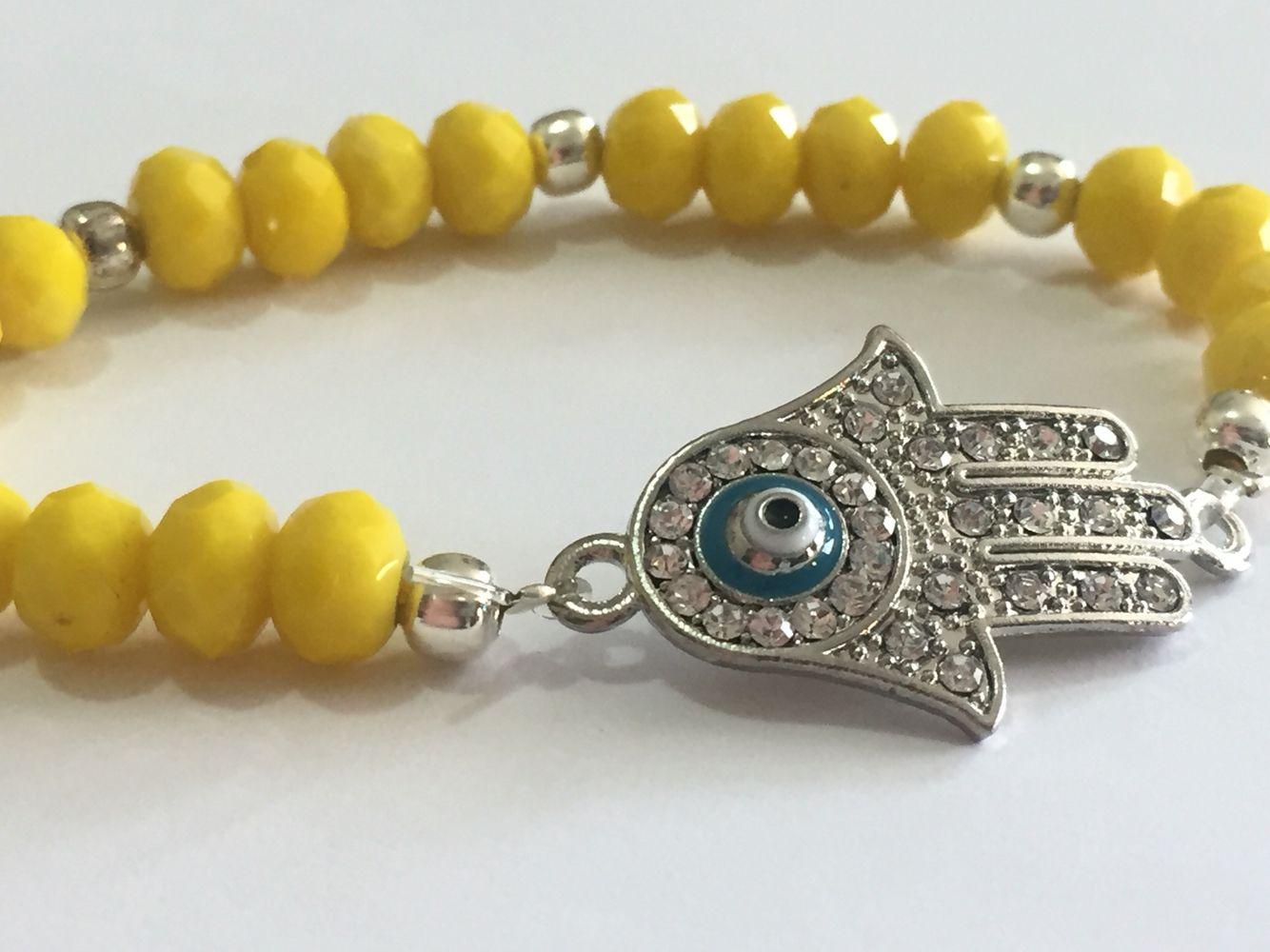 d5d5f82da038 Pulsera amarilla con dije mano de Fatima