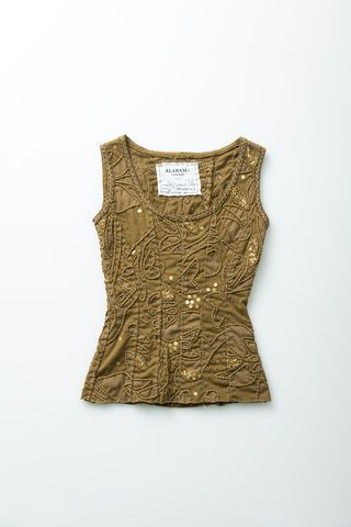 """With princess seams and a low neckline, our Celia Corset has a feminine fit and flattering silhouette. This corset is hand embroidered, features accent beading, and is hand sewn in a double layer of 100% organic medium-weight cotton jersey. • Measures 23"""" from shoulder  • Shown in Ochre in size Small  • Choose your color and size below  • Wash gently + Hang to dry  • Hand made in the USA  • Please allow three to six weeks for delivery"""