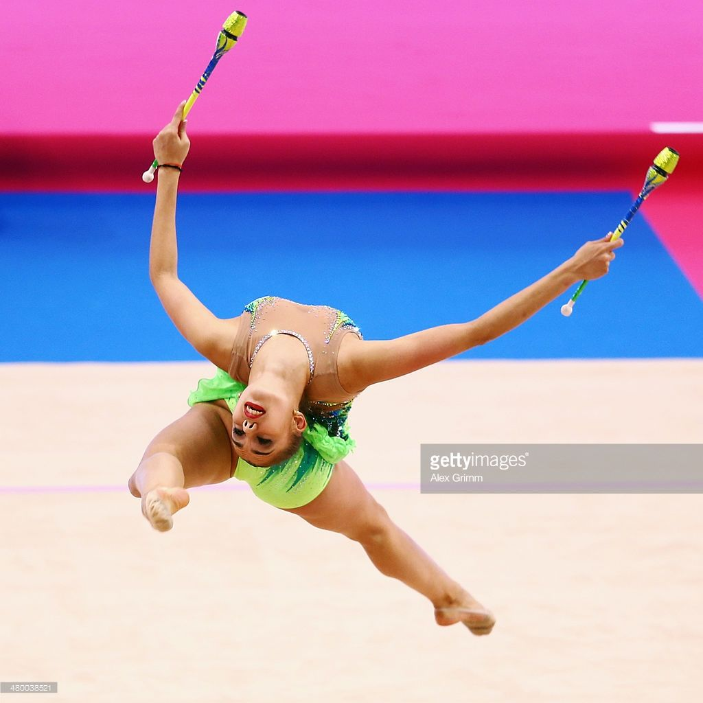 Margarita Mamun of Russia performs with the clubs during the individual competition of the GAZPROM World Cup Rhythmic Gymnastics at Porsche Arena on March 22, 2014 in Stuttgart, Germany.