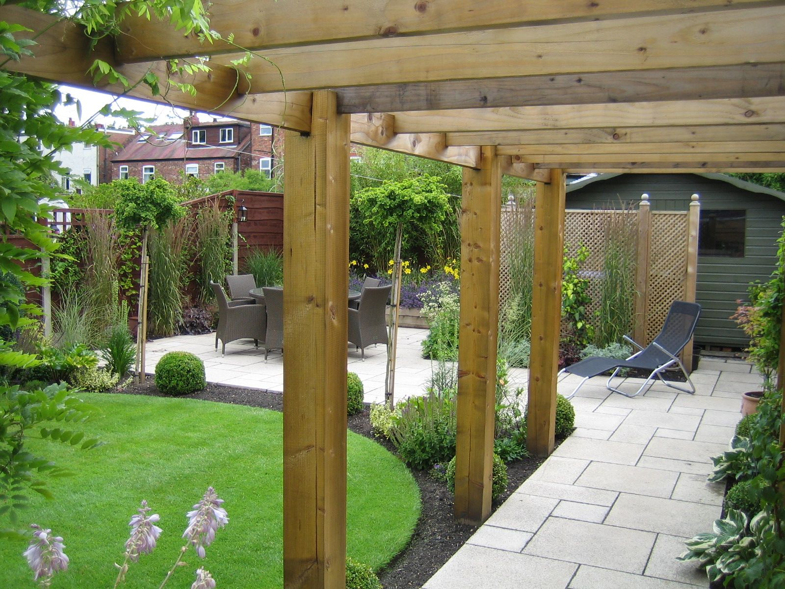 Timber Pergola Using Chunky Posts To Support Cross Beams