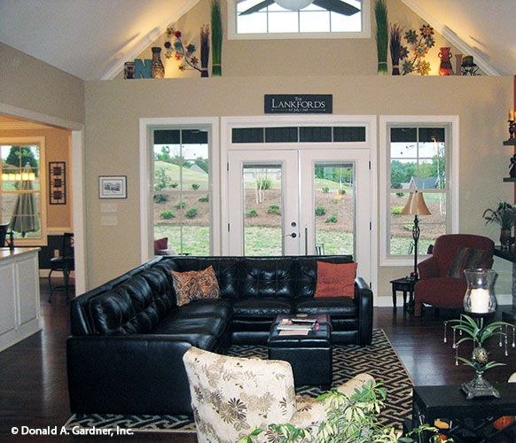 Great room with a cathedral ceiling and plant shelves! The Peyton #1289. http://www.dongardner.com/house-plan/1289/the-peyton. #GreatRoom #HousePlan #HomeDesign