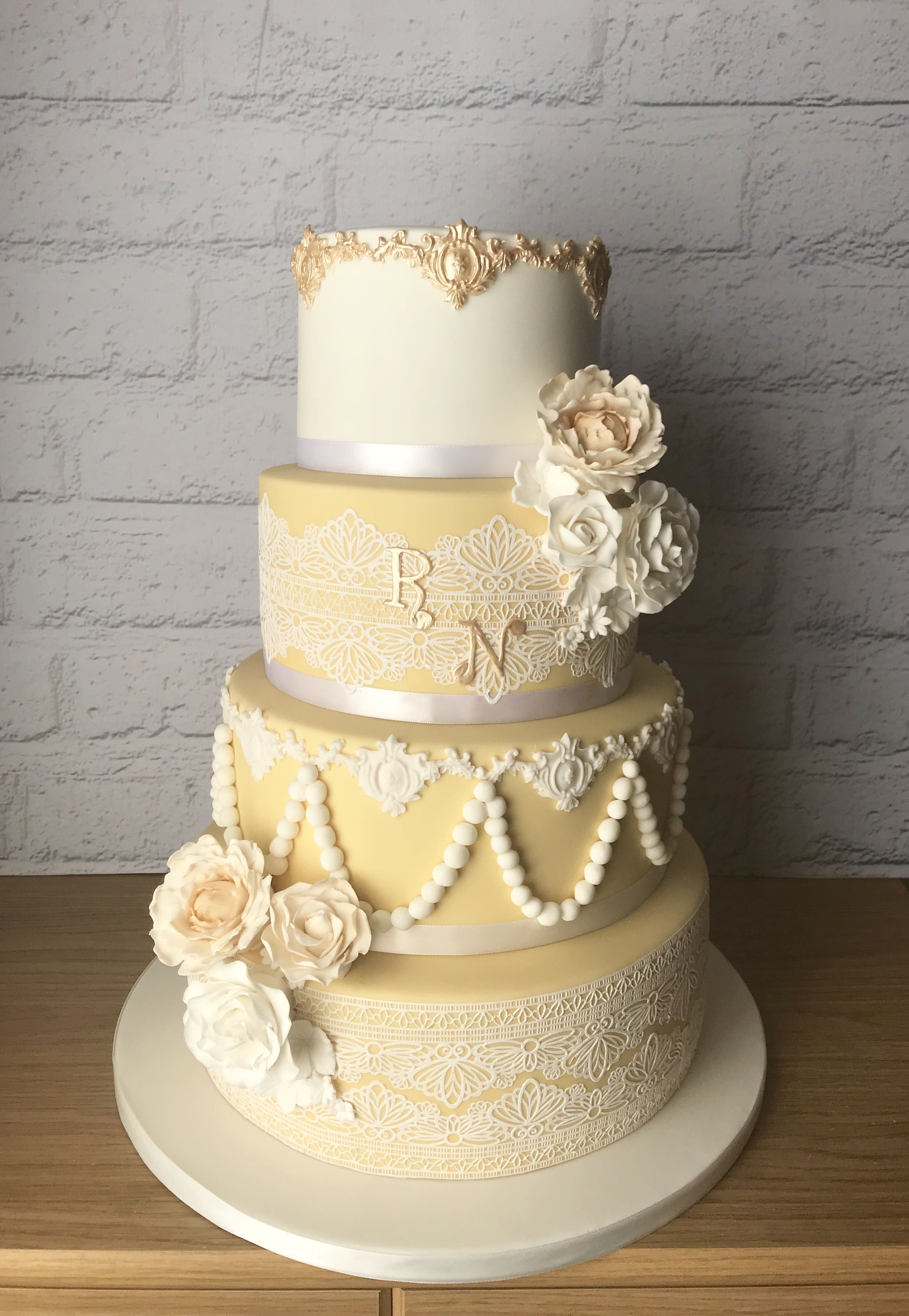 Pale gold and white wedding cake with edible cake lace | Taylormade ...