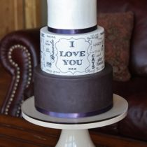 Hand painted typography wedding cake with words chosen by bride and groom, by Sweet and Swanky Cakes.