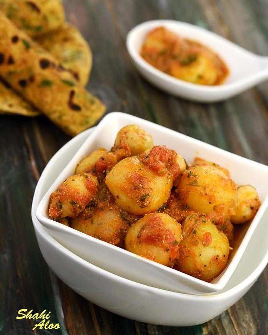 Shahi Aloo Ingredients 14 To 16 Boiled And Peeled Baby Potatoes 3 Tbsp Oil 1 Cup Finely Chopped Tomatoes 3 Tbsp Curds Dahi Recipes Subzi Recipe Aloo Recipes