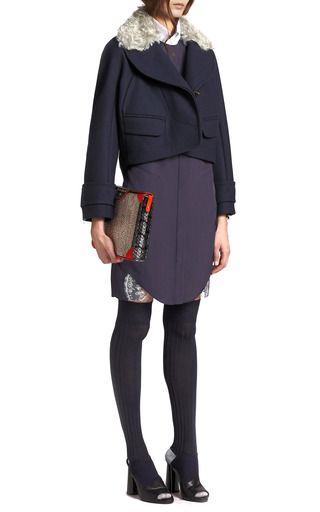 This cropped wool jacket from Carven features a mohair-trimmed shawl collar, full-length sleeves with zip details, and flap front pockets Concealed button fastenings 80% virgin wool, 20% polyamide Fully linedImportedPlease note: This item is returnable for credit or full refundShoes and accessories are for styling purposes only