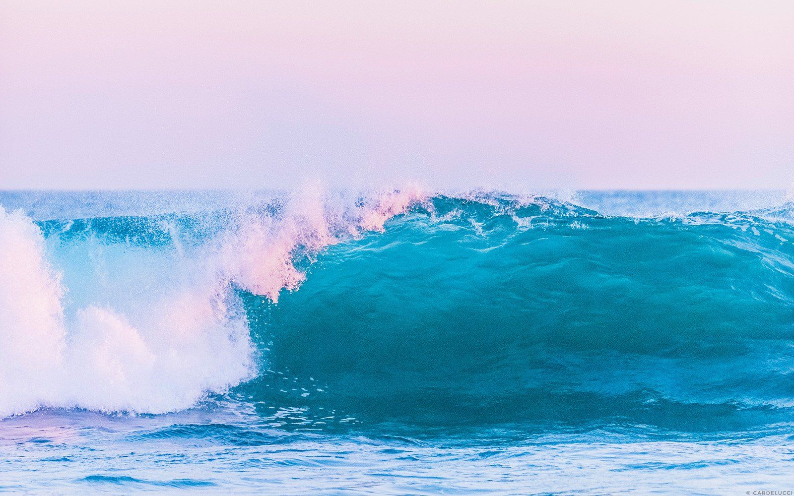 Vibrant Pink And Blue Hues Of The Ocean • Photo By