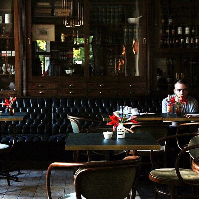 The young man who sits alone in a cafe ☕️⏳ #vintage #pharmacy #cafe #interior #design #classic #classicstyle #berlin #berlincity #berlinstagram #travel #travelinberlin #explore #decor #decoration #decorations #vintagestyle #coffee #coffeetime #coffeelover  #coffeeshop #germany #travelingermany #travelphotography