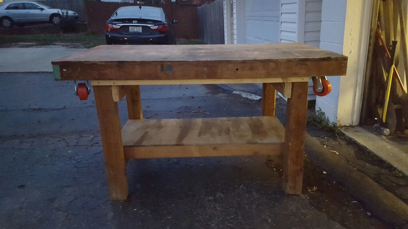 This work bench doubles as a super heavy moving dollie. 3/4 plywood, 2x4 framing, 600 lb casters. The dollie lifts off & back on the bench. No need to store an extra piece of equipment that is used once in a while.