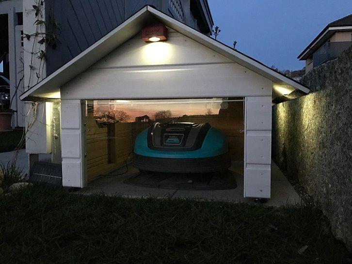 2017 Version Of Robotic Lawn Mower Garage Switzerland S Cooles Robotic Lawn Mower Garage With Solar Led Lights Robotic Lawn Mower Lawn Mower Solar Led Lights