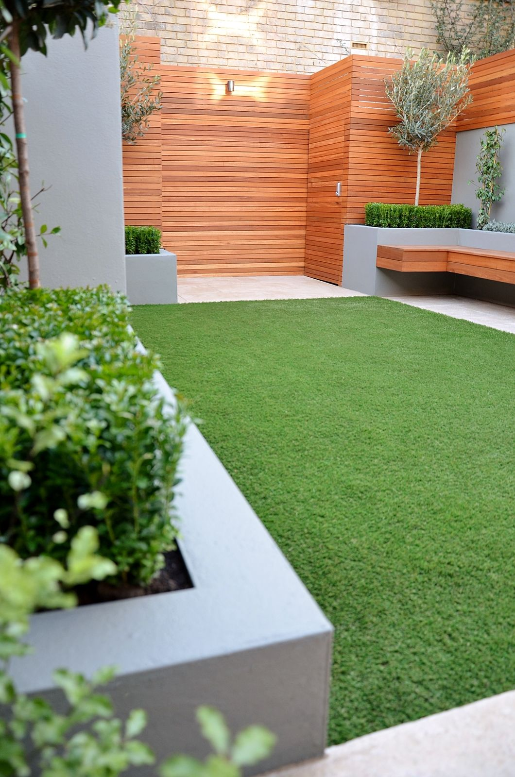 Garden Design Artificial Grass hardwood screen raised beds in grey floating bench bespoke storage
