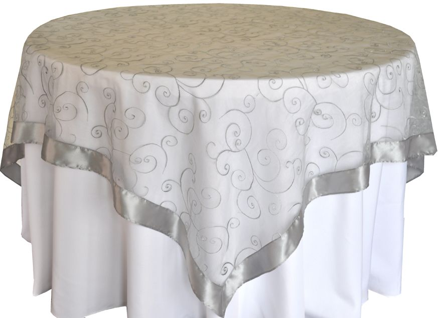 72 Square Embroidery Overlay Silver Over 108 White Poly Cloth On A 48