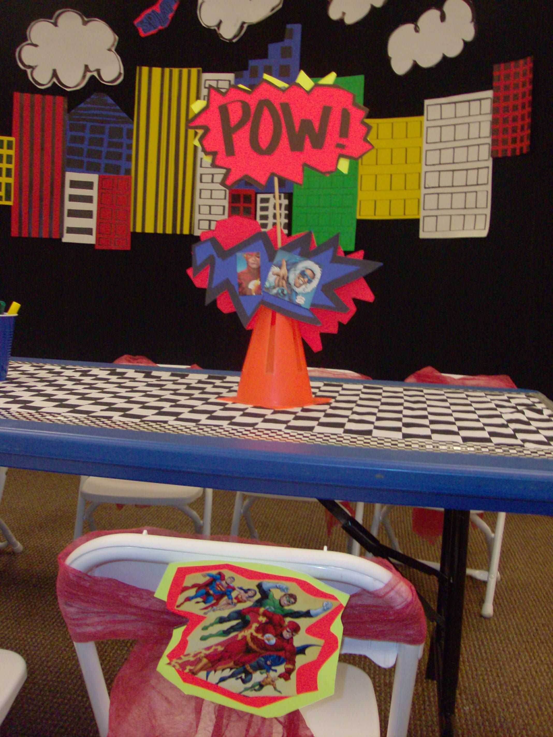 Super Hero Party centerpieces and hanging cartoon clouds
