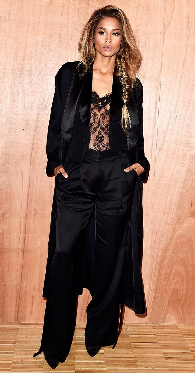 1bab3f0a489 Ciara wears a black silk tuxedo suit and a black lace bustier.