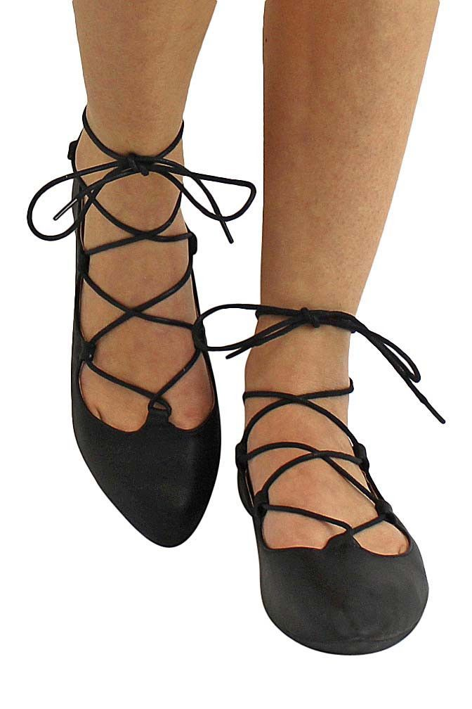 Slim lace-up cords add ballet-inspired sophistication to a prim pointy toe  fashioned from faux leather. Add a touch of classic femininity to flowin…