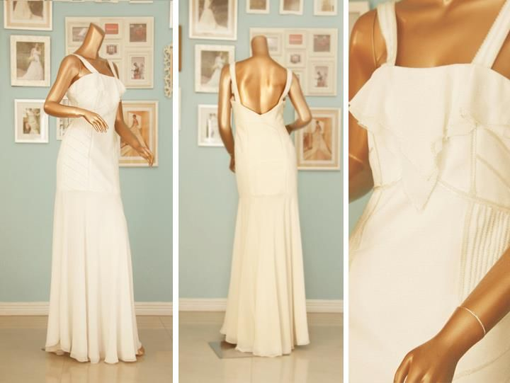 Soft backless wedding dress with beaded details and a drop waist silhouette.