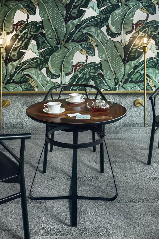 UGO architecture wraps warsaw tea room in leaf wallpaper