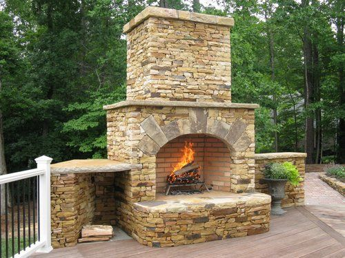 outdoor fireplace built into raised deck irwin