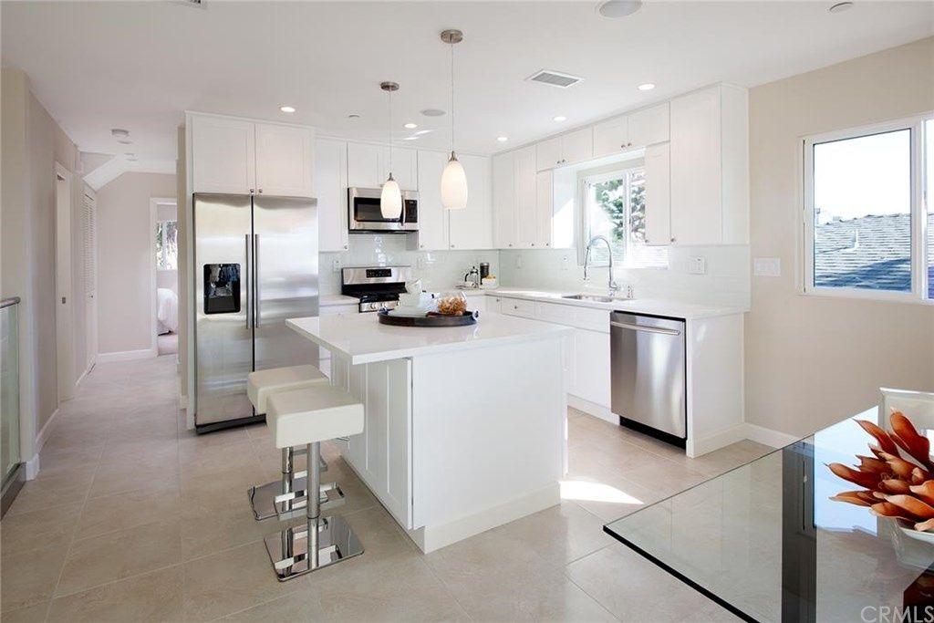 Contemporary Kitchen with Pendant light, Kitchen island, Flush, Stone Tile, High ceiling, limestone tile floors, L-shaped