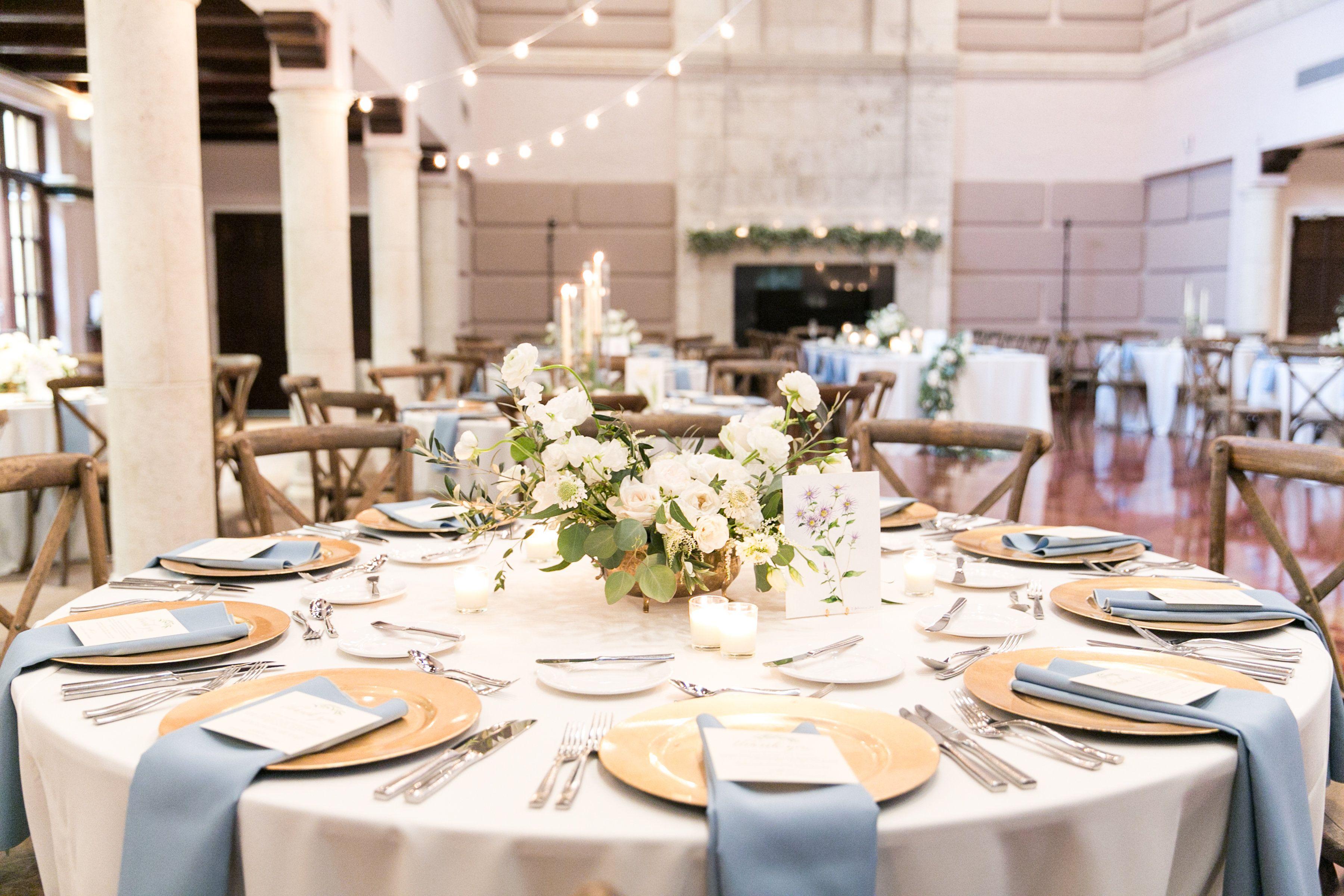 Lush Reception Table Arrangement Of White Cloud Garden Rose White Lisianthus White Scabiosa Whi Blue Gold Wedding Blue Table Settings Wedding Place Settings