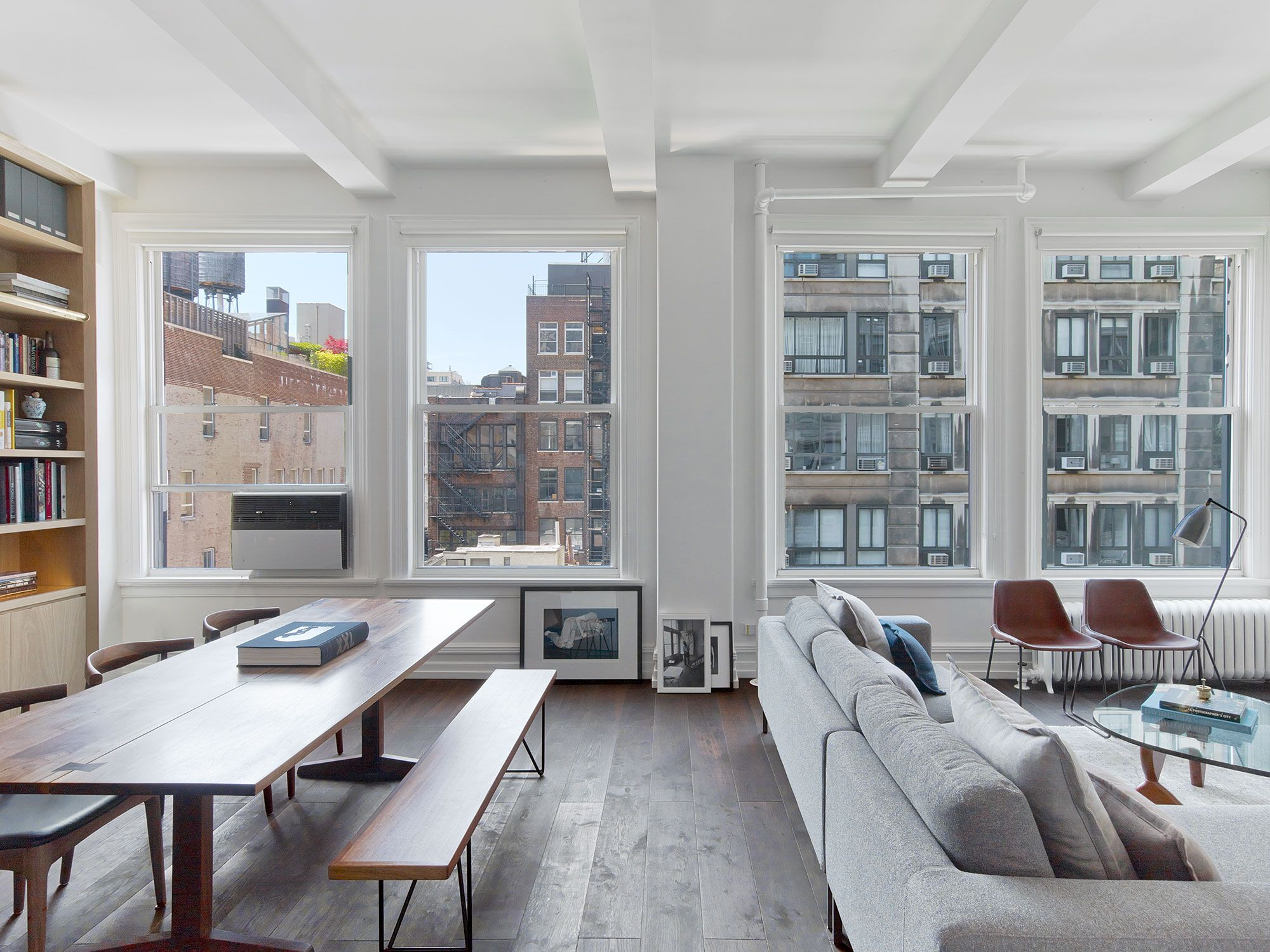 inside a minimalist new york city apartment filled with natural