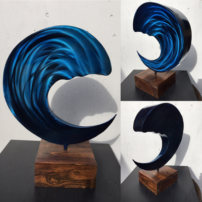 "Blue Moon Breaker ​21"" x 16"" x 8"" steel, blue solvent, clear coat cocobolo base the piece also swivels in the base"