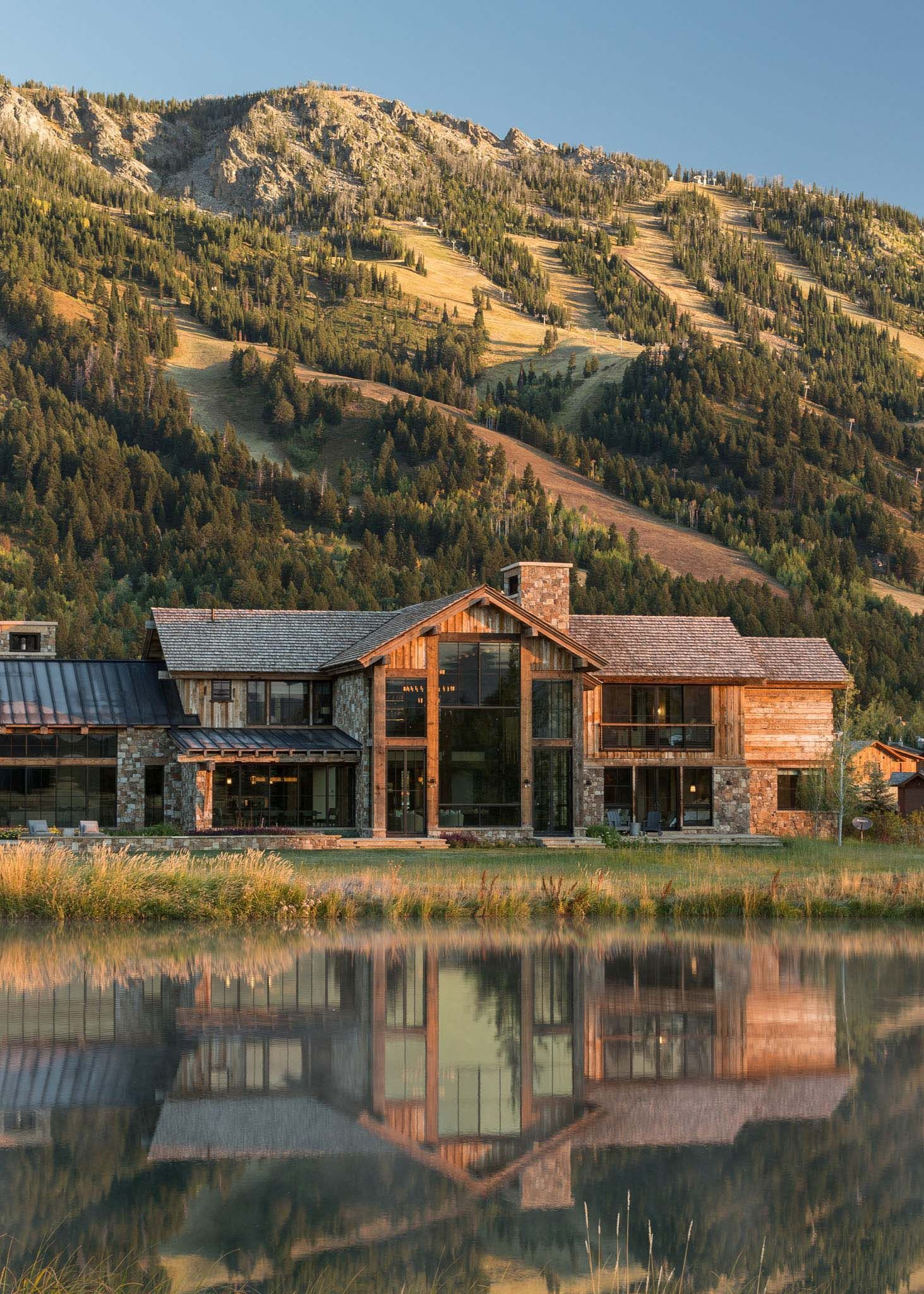 Delightful rustic home in Wyoming with a dramatic mountain backdrop  Ranch style homes exterior