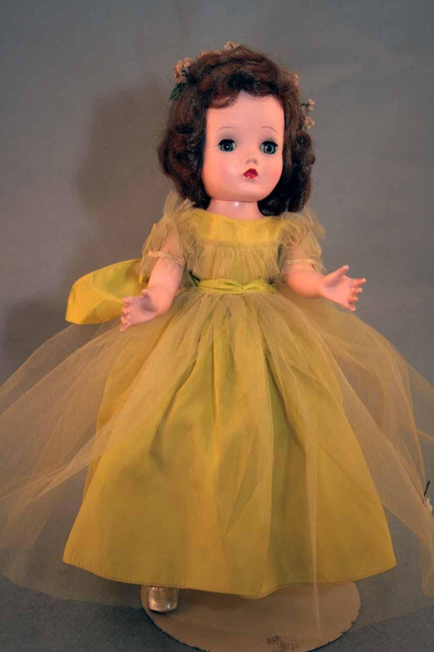 Binnie hard plastic doll by madame alexander 14 tall in chartreuse binnie hard plastic doll by madame alexander 14 tall in chartreuse bridesmaid dress marked binnie walker with cissy face from 1954 1955 ombrellifo Images
