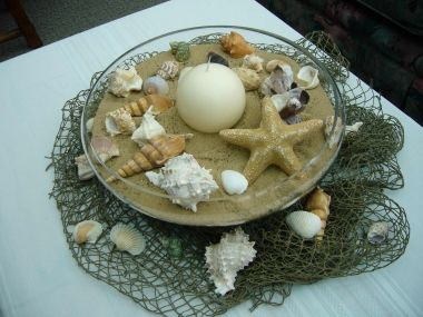 Use The Fishing Net As A Table Runner And Bowl Of Shells With Some