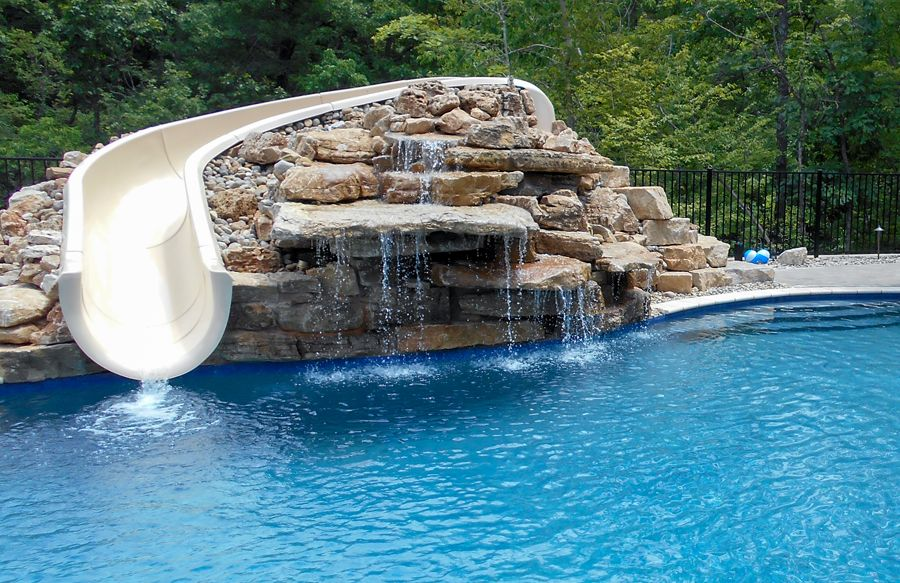 Swimming Pool Rock Slides Photos Blue Haven Pools In 2020 Swimming Pool Slides Pool Swimming Pools