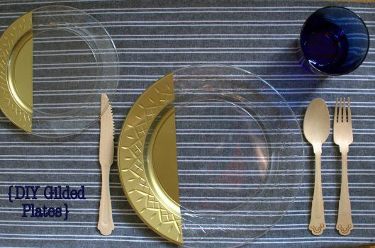 Spray paint the back of clear disposable dinner plates gold for a DIY gilded look that's safe to eat off of and looks fantastic!