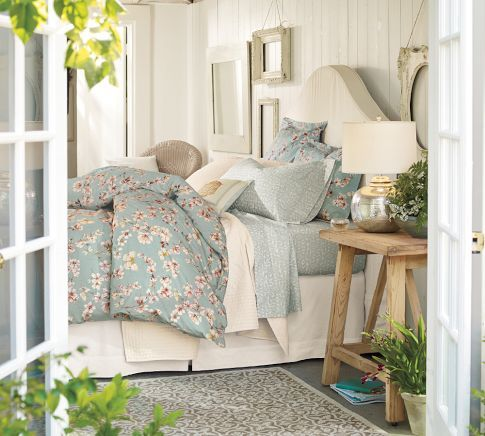Cherry Blossom Organic Duvet Cover & Sham... for the single girl. No way any guy should have to sleep on this much floral. Love the french doors too