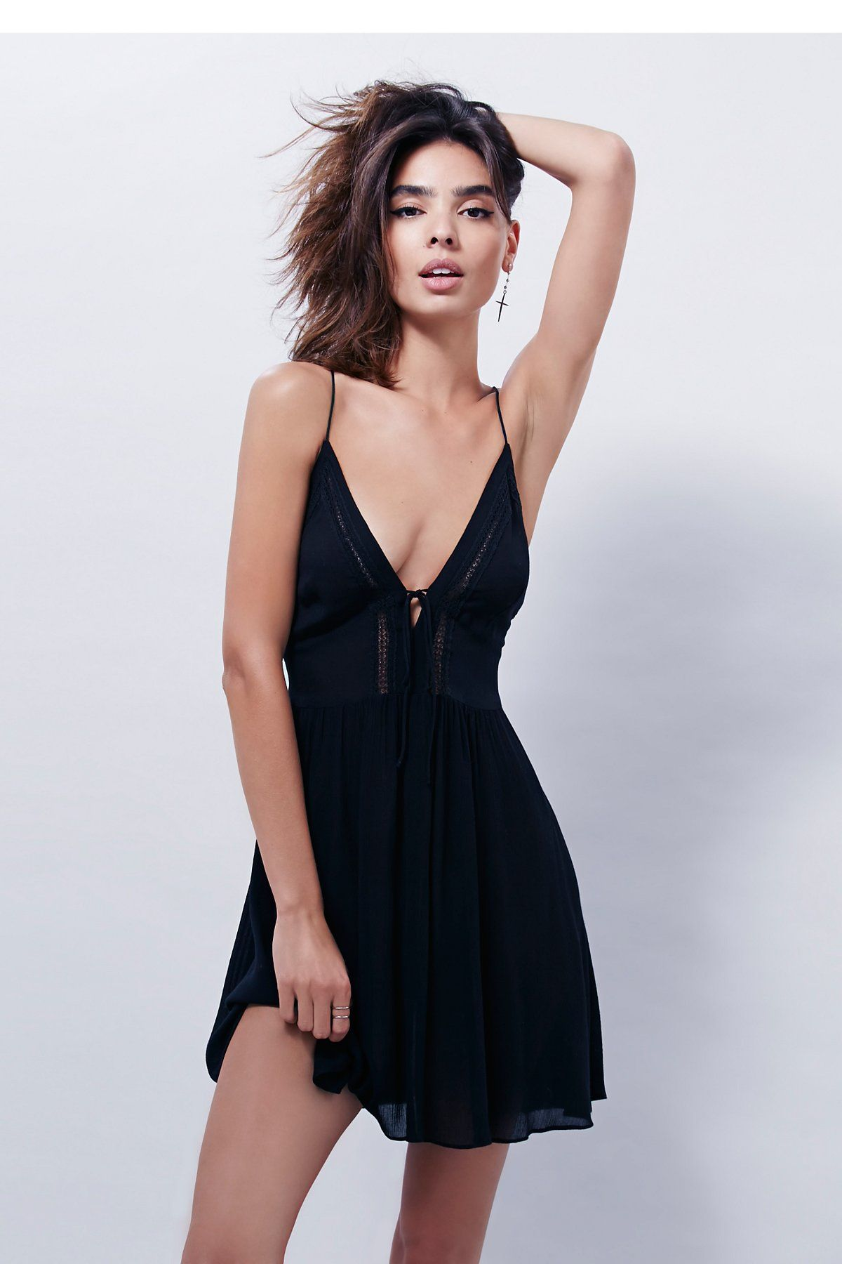 760a105a01 First Love Fit + Flare | Sheer fit and flare dress with crochet accent  along bust and back. Thin straps and tie detailing in front and back.  Unlined.