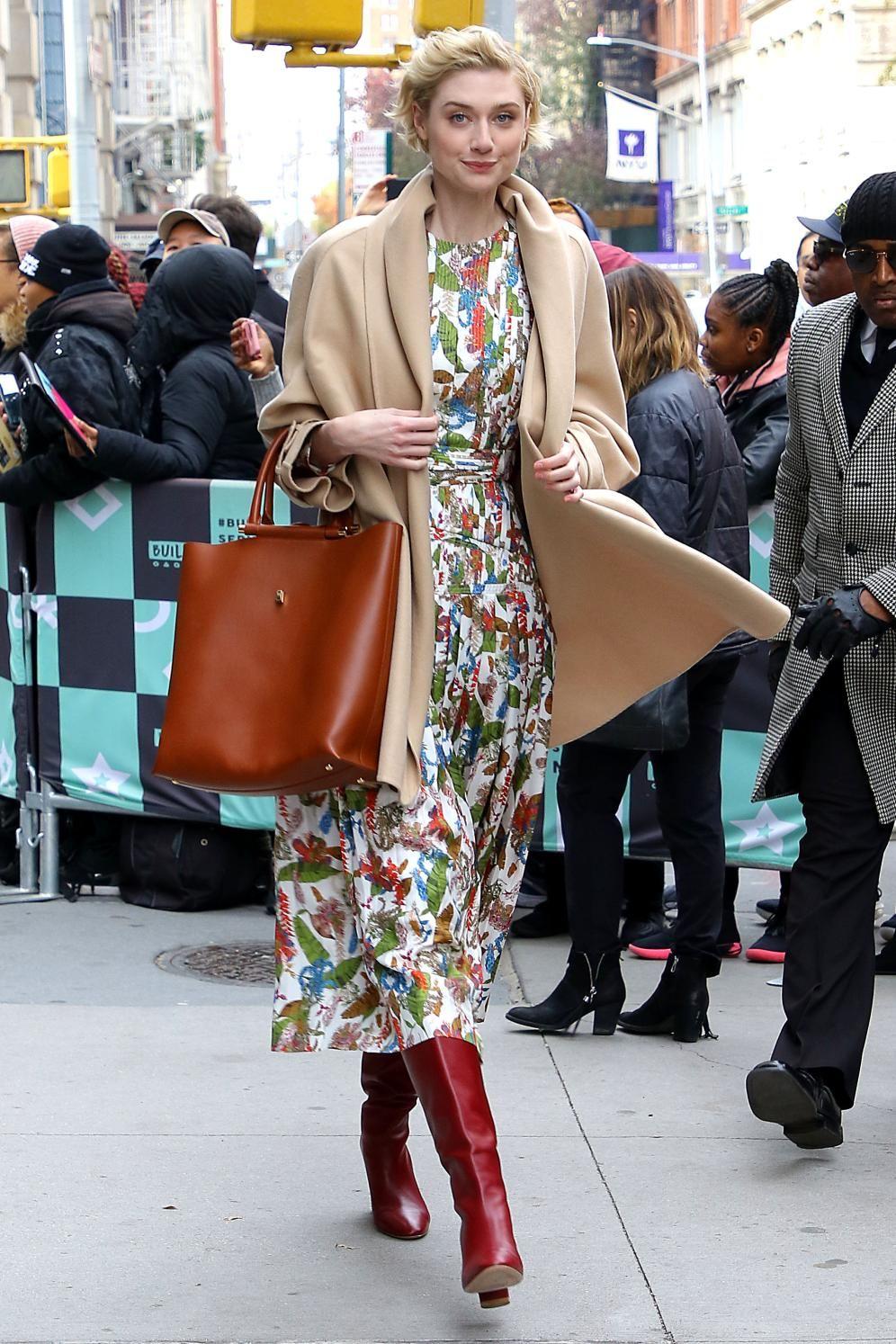 Midiskirt + tall boots = the look of the season White