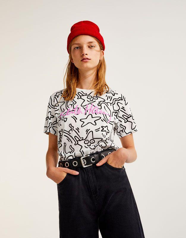 3a3dbb7d8760 Pull Bear - donna - abbigliamento - magliette - t-shirt keith haring stelle  - bianco