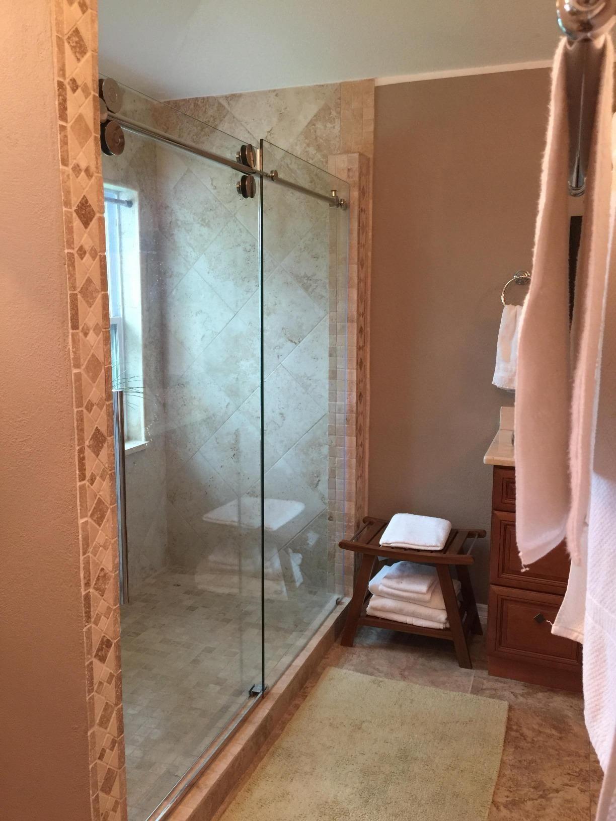 The Adjustable Opening Sliding Shower Door Is Between 56 60 With