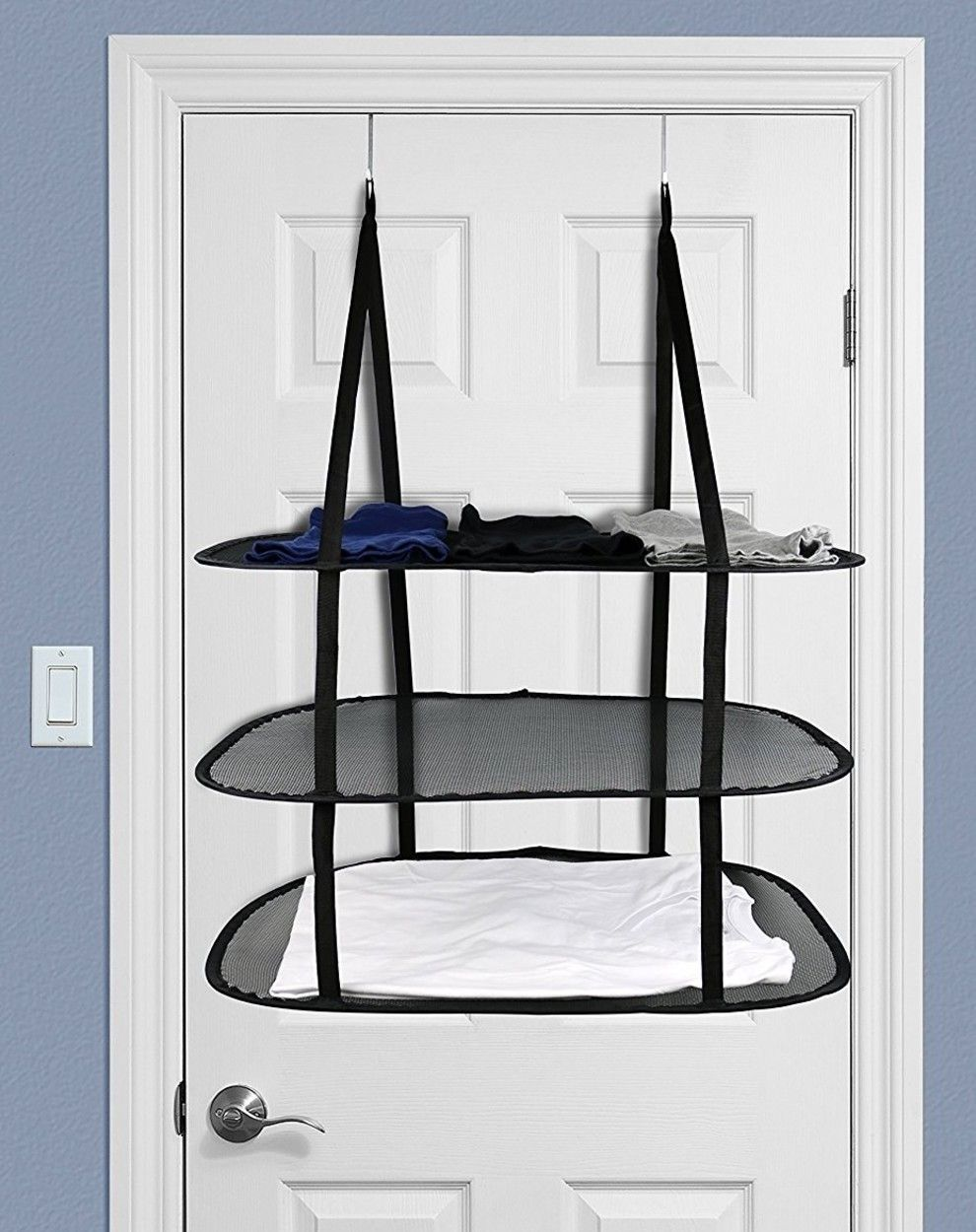 An overthedoor drying rack to solve the annoying lay